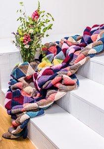 Decke häkeln: So gelingt die Wolldecke im Patchwork-Stil